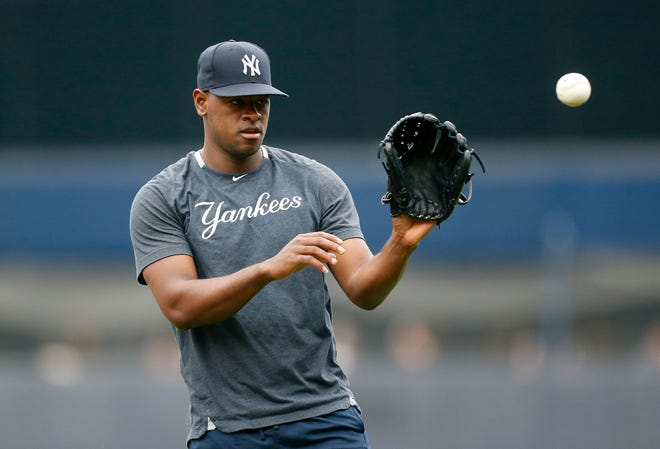 Luis Severino of the New York Yankees warms up on the field prior to a game against the Tampa Bay Rays at Yankee Stadium on June 19, 2019 in New York City.