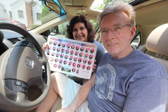 Tom and Linda Morrison of Westwood traveled to the homes of every US president (except Obama and Trump) over the past 10 years. They collected photos, t-shirts and memories from each place they visited. A place mat with all the US presidents homes the Morrison's visited. They put a pink sticker on the president to signify the homes they visited. On July 12, 2019 in Westwood, they sit in their Honda, the same car they've driven to take them on their presidential journey.