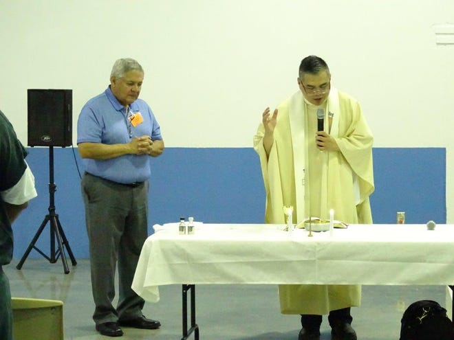 Reverend Arturo de Guzman from Most holy Trinity Catholic Church from El Paso, Texas, held a religious mass service for a group of inmates at the Otero County Prison Facility in Chaparral on Thursday, July 11.