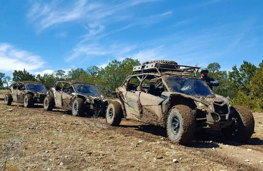 Guests enjoy an excursion in the backcountry driving through mud, up and down hills, and on twisting terrain.