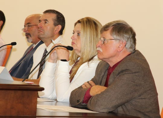 (From left) Lee White, John Ross Null, Lavern Shan and Dr. John Gratton sit in on the Eddy County Energy Advisory Board meeting July 11 in Artesia.