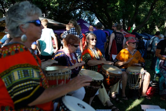 Members of the Ashay Drummers play during Aztec's National Night Out at Minium Park on July 17, 2018.