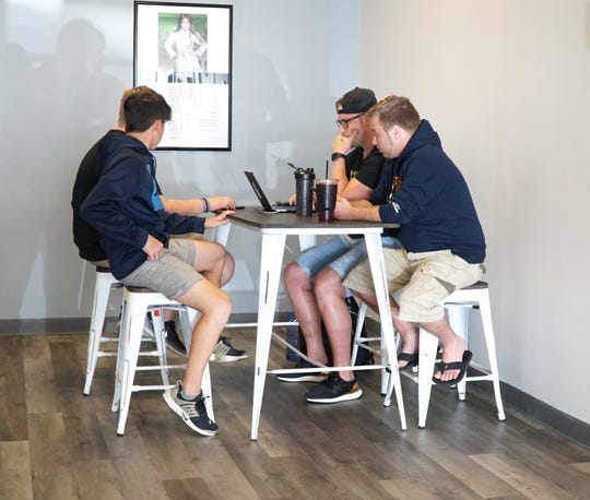 Some Iced Fusion Nutrition regulars enjoy some flavored teas at the Canton location on July 12.