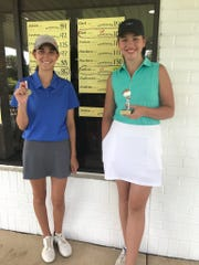 Maire Sullivan (right) captured the girls' 12-18-year-old division with a score of 89. Amelia Gatti (left) shot 100 and was runner-up.