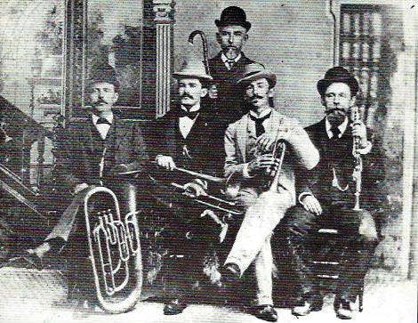 The Breaux Bridge Brass Band that participated in the 1901 July 4th Opelousas parade and entertained at the event. Band members pictured here in 1898 include l-r bottom row: Klebert Melancon, P. Lee Begnaud, Jean Durand, and Leonce Ransonet. Standing: Cypriene Melancon.