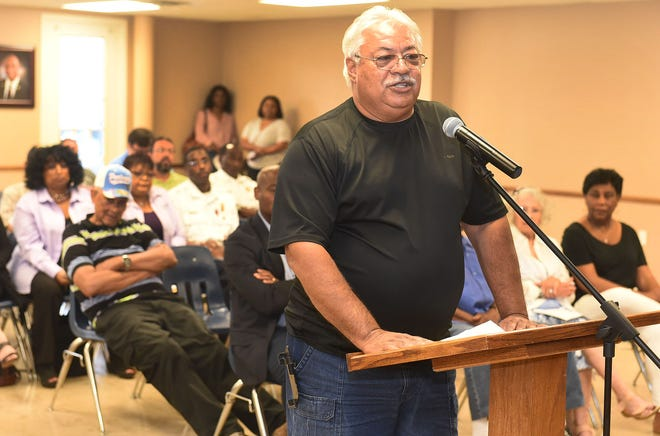 Opelousas resident Paul Gennuso addresses the mayor and board of aldermen concerning CLECO  during Tuesday's monthly meeting.