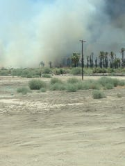 A growing brush fire burns of Highway 86 in Mecca at Avenue 66. Expect traffic delays in the area.