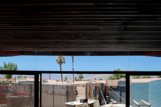 A view of the mountains can be seen from inside as renovations continue on the historic Palm Desert Wave House on Thursday, July 11, 2019.