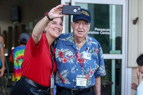 Julie Luttrell takes a quick photo of herself and Navy veteran Frank Emond, 101, a Pearl Harbor survivor, on Friday at the Pensacola Aviation Center.