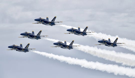 The Blue Angels take to the skies over Pensacola Beach for a limited show on Friday, July 12, 2019.