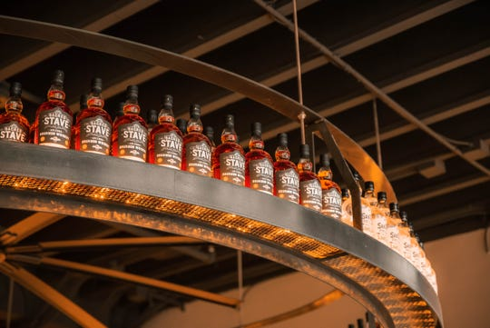 Bottles of spirits hang above the bar at Spirit House.