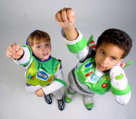 """Sawyer was so into the """"Toy Story"""" movies when he was little that he wore a Buzz Lightyear costume almost every day for a year. Here in 2002, at 3, with friend Sam Mosley, 5."""