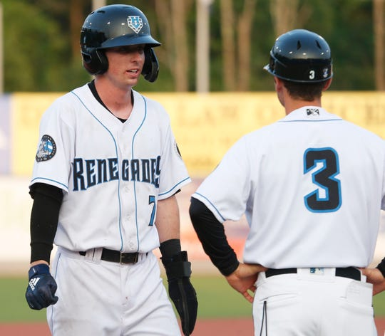 Hudson Valley Renegades Nick Sogard talks with manager Blake Butera at third base during Wednesday's game at Dutchess Stadium in Fishkill on July 10, 2019.
