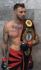 Wappingers Falls' Andrew Geisler, an amateur MMA fighter, won the Cage Wars featherweight title last month.