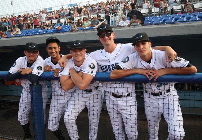 Players in the home dugout during Champions Night at Dutchess Stadium in Fishkill on July 10, 2019.