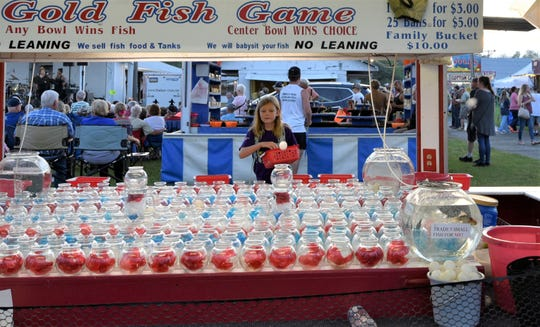 Claire won a goldfish at the Franklin County Fair on Thursday evening for her perfect shot into a glass bowl.