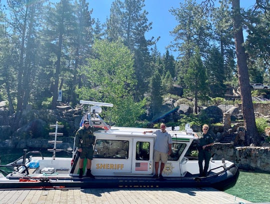 Members of the Washoe County Sheriff's Office Marine 9 crew, who took part in the rescue of a near drowning victim at Lake Tahoe on July 5, pose for a photo. The crew includes Deputy Randy Hill (left), civilian boat operator Ron Rosa, and Deputy Heidi Pickard.