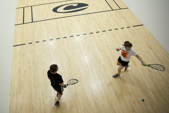Freshman students from Sprague High School practice racquetball at Courthouse Club Fitness in Salem on July 11, 2019.