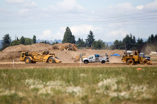 Pesticide contaminated soil is cleaned up so homes and apartments can be built on 150 acres in Northeast Salem on July 12, 2019.