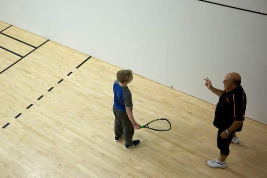 Sprague racquetball coach Bill Edmiston coaches a student during practice at Courthouse Club Fitness in Salem on July 11, 2019.