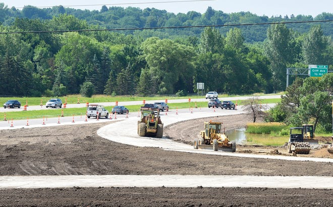 Construction workers near completion of Interstate 229 entrance and exit ramps at 26th Street on Friday, July 12, in Sioux Falls.