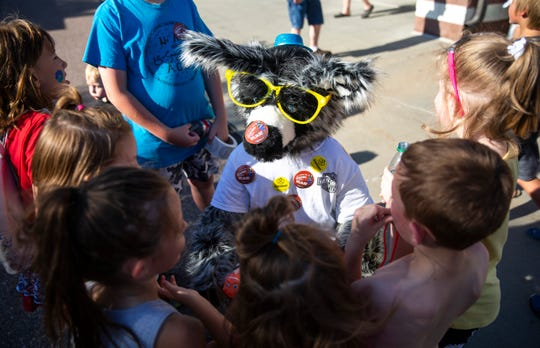 Wilbur, aboard his tricycle, grabs the attention of a crowd of kids attending the 24th annual Hot Harley Nights, Thursday, July 11.