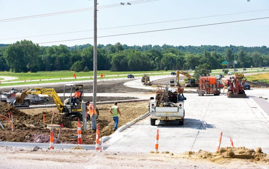 Construction workers make headway on Interstate 229 entrance and exit ramps at 26th Street on Friday, July 12, in Sioux Falls.