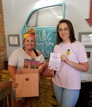 Pictured are Meagan Vawter and Callie Garbee, the owner of Two Saved Sisters Boutique. Vawter is collecting bras for Harmony House and Least of These. Find a collection bin at Garbee's business in Ozark.