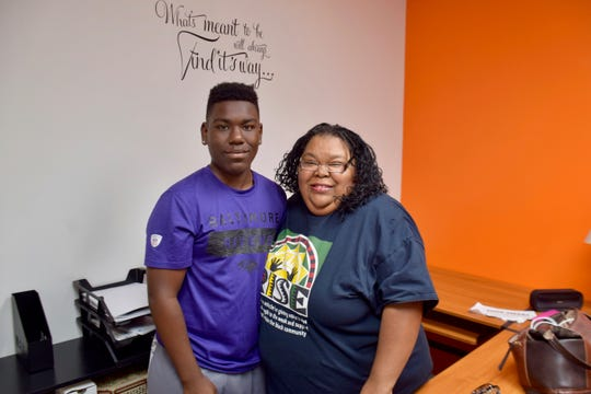 RISE co-founder Chanda McGuffin and her son Shakil McGuffin pose in the RISE office in summer 2019.