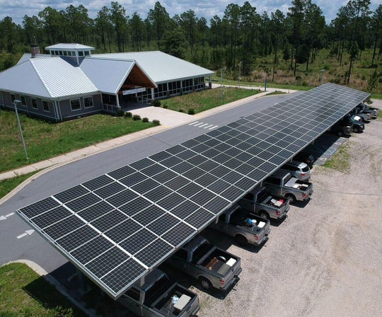 Drone photo of our solar cells and metal roof, plus a view of our beautiful natural landscaping.