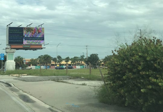 The billboard at the site of a $1.3 million sale of city property to a car wash dealer is expected to remain in the hands of the city of Stuart.