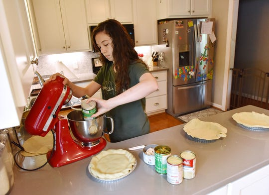 Mattison Hayes prepares chicken pot pies at her family home in Easley.