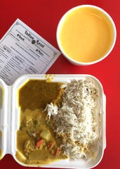 Menu options at Indian Rasoi in Ventura include a plate -- actually a biodegradable to-go container -- filled with diner's choice of two entrees and basmati rice for $9.99. Dahl and veggie korma entrees are pictured here with mango lassi ($2.99).