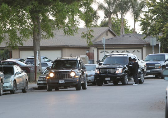 The parking shortage around the Southwinds area is among concerns of people who live in south Oxnard. Here, two people double park talk to each other.