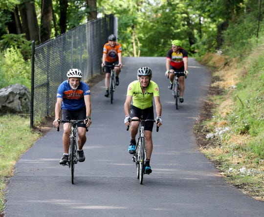 Left to Right, Dave Zornow, Mike Hays, Seth Reichlin and Mark Garrahan are the first riders on the new Greenbush Road bypass bike path in Blauvelt, July 12, 2019..