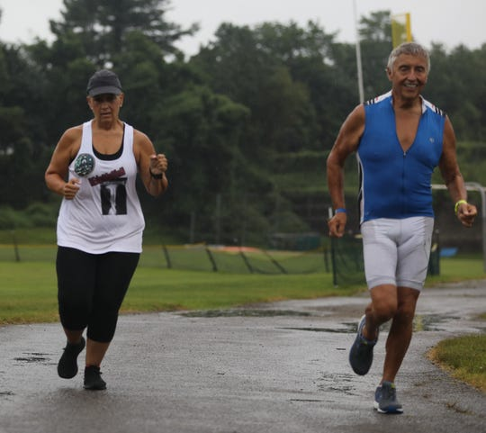Port Chester's Don Cassone, who dropped 150 lbs, and Yonkers' Laraine Batis-Gelpi, post-reconstructive ankle surgery go for a mini run at White Plains High School July 11, 2019.  Cassone and Batis-Gelpi will compete in the NYC Triathlon.