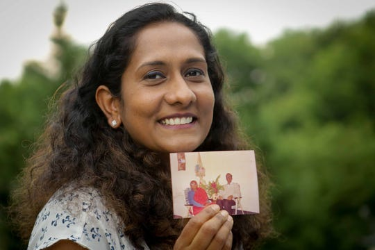 Dr. Anuradha Amara, a physician at Christiana Care Health System is a mother of two children and her husband is also a doctor. She holds a picture of her grandfather who was a self-taught doctor back in her native Southern India. He encouraged all his children to become doctors and to go to America, especially girls, for a better opportunity. Because of current quotas and a growing backlog, some India-bornÊdoctors will never have the chance to obtain permanent residence in their lifetime.