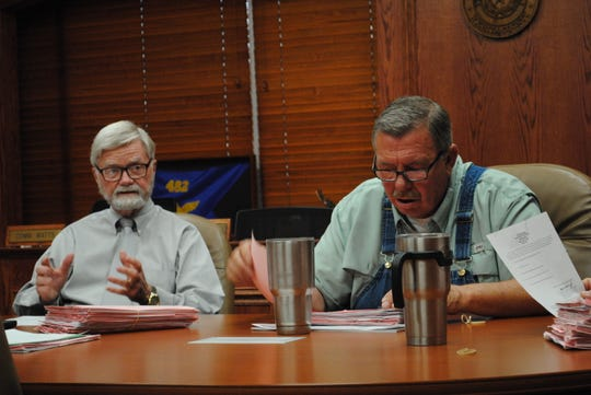 "Wichita County Judge Woody Gossom, left, is seen Friday morning during a county commissioners work session. Gossom is under inquiry for allegedly failing to conduct ""judicial functions"" for at least 40 percent of his work time but receiving an 18 percent annual compensation."