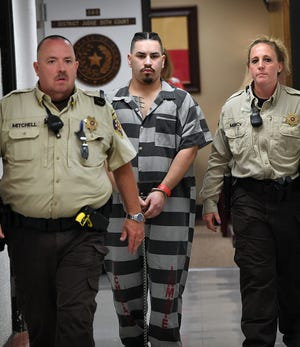 Wichita County Jail inmate Joshua Cook is escorted from 30th District Court Friday afternoon after a bond reduction hearing.