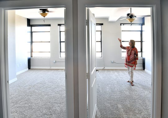 Property manager Carol Whitehead notes that The Landmark on Lamar apartments include one and two-bedroom units with lots of windows.