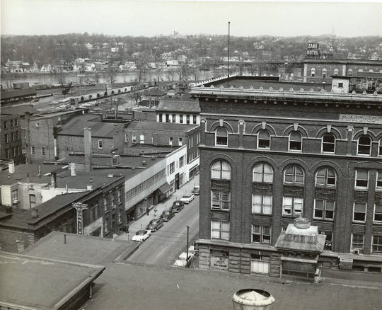A view looking toward the river in an undated photo from the 1950s. The photographer was perched on the roof of the Muskingum County Courthouse. The Masonic Temple is at right.