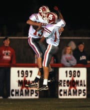 Sheridan's C.J. Myers and Anthony Crane celebrate a Myers' touchdown against Crooksville during the 2010 season at Village Park. The Generals finished 11-1 as Myers produced almost 2,000 total yards.