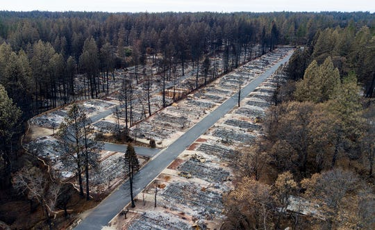 Homes leveled by the Camp Fire line the Ridgewood Mobile Home Park retirement community in Paradise, Calif. New figures released by California Gov. Gavin Newsom show the town of Paradise lost over 90% of its population since last year's devastating Camp Fire.