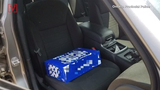 Canadian police pull over a driver after they discover he was allegedly using a case of beer at a child booster seat.