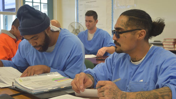 "Students at Tehachapi prison work to create oral reports on how various communities in California enforce the ""three strikes"" law."