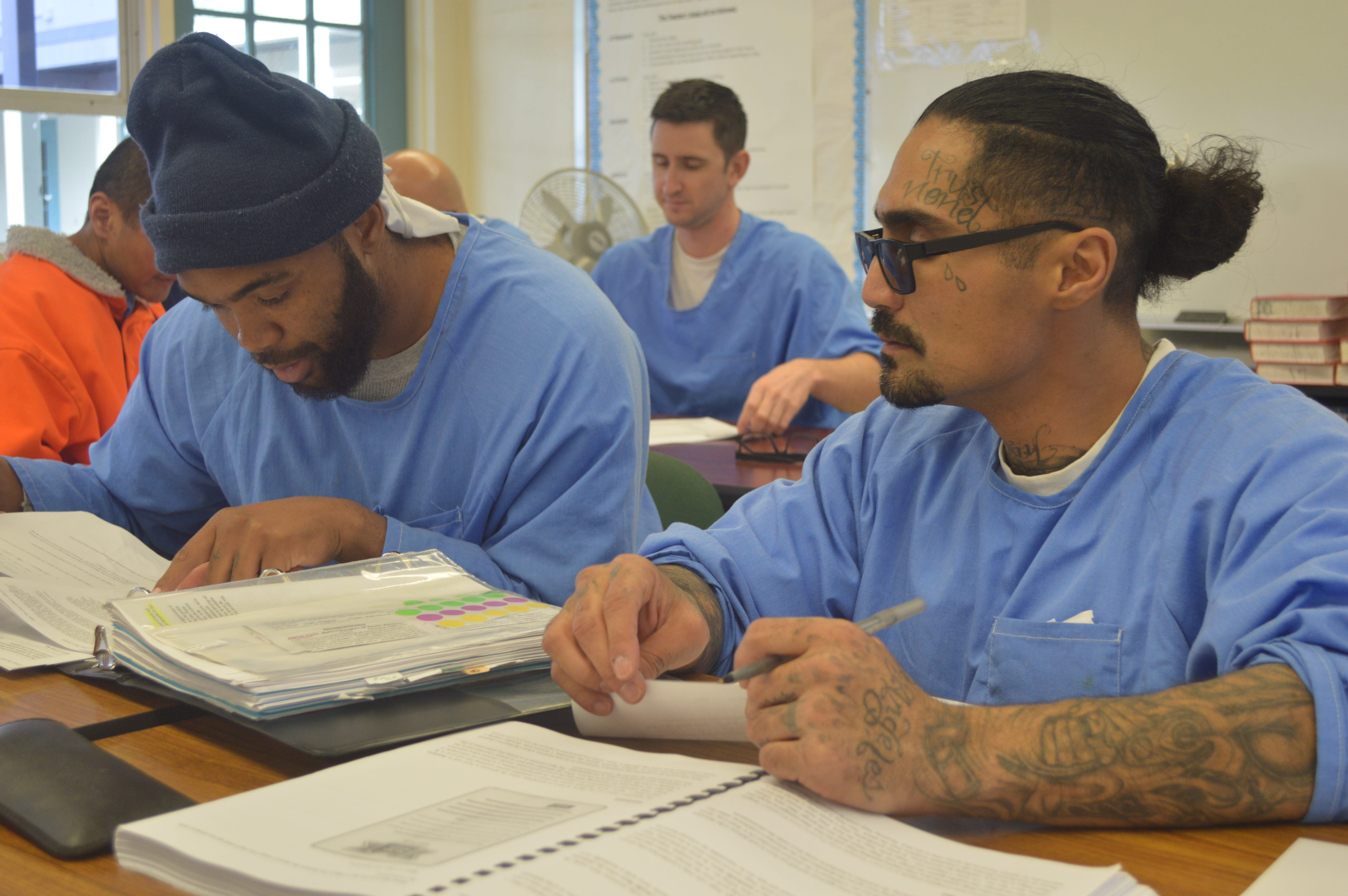 Students at Tehachapi prison work to create oral reports on how various communities in California enforce the three strikes law.