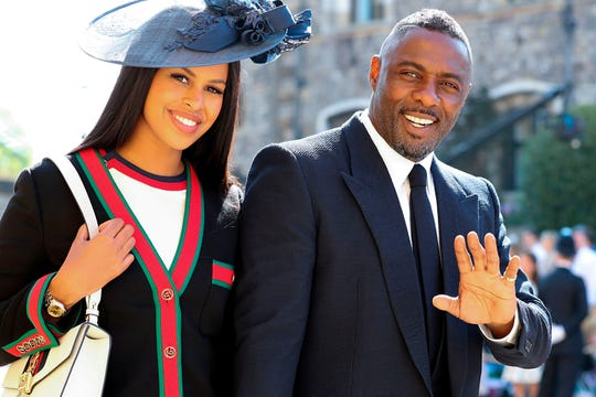 British actor Idris Elba (R) arrives with his fiancee Sabrina Dhowre (L) for the wedding ceremony of Prince Harry and Meghan Markle at St George's Chapel, Windsor Castle, in Windsor, on May 19, 2018.