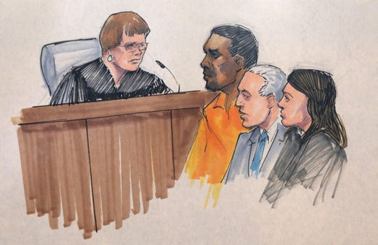 In this courtroom sketch, R. Kelly, center, appears before U.S. Magistrate Shelia M. Finnegan in the Northern District of Illinois, on July 12, 2019, in Chicago. Also standing with Kelly is his attorney Steve Greenberg and an unidentified prosecutor.