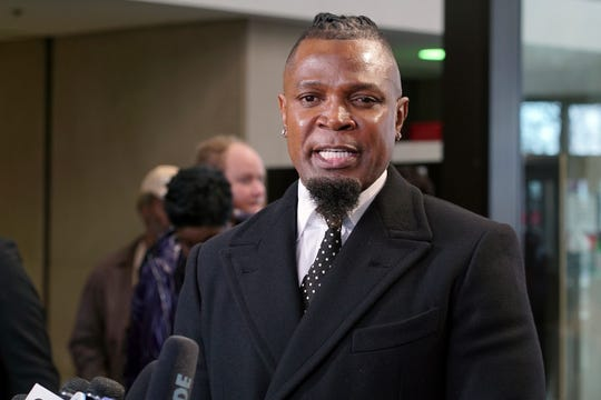 Darrell Johnson, publicist for R. Kelly, speaks to the media after R. Kelly appeared at court in Chicago on March 22, 2019.