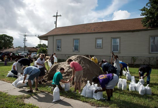 Residents fill sandbags in the St. Roch neighborhood of New Orleans on July 11, 2019.